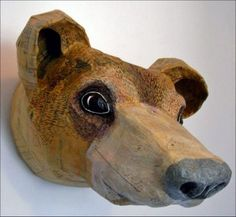 animal heads made completely from recycled cardboard, newspaper, boxes and magazines