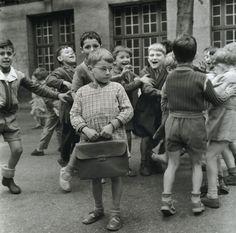 """Enfant sage en cour de récréation Paris, 1954. From Robert Doisneau: Retrospective """""""