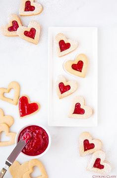 These are perfect for Valentines Day. Delicious with almonds and raspberry jam but hazelnuts and strawberry jam would be great too.