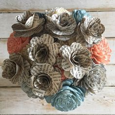 Coral blue and natural bouquet with book pages!  Shop: NovelExpression.etsy.com  #etsy #etsyseller #rusticwedding #weddingbouquet #wedding #weddings #isaidyes #engaged #book