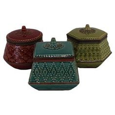 """Set of three ceramic jars with textured geometric designs and coordinating lids.    Product: 3 Piece jar setConstruction Material: CeramicColor: Red, blue and greenDimensions: 6"""" H each"""