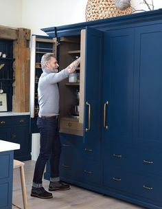 The pantry and adjacent integrated fridge read as one seamless unit for an authentic country feel. Kitchen Storage, Locker Storage, Coin Café, Style Anglais, English Farmhouse, Integrated Fridge, Laundry Room Inspiration, Exposed Beams, Kitchen Cabinetry