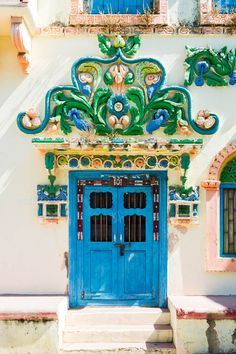 One of the colorful doors of Diu, India. Diu is a small town in west India, and its cheap drinks and Portuguese history make it a must-see for all travelers in India.