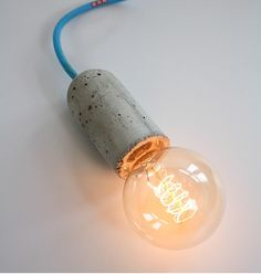 Concrete light bulb by NUD Collection