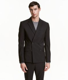 Black. PREMIUM QUALITY. Double-breasted blazer in Italian wool fabric. Slightly wider lapels, one with decorative buttonhole. Chest pocket, front pockets