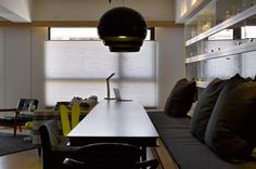 dining area with black Kartell FL/Ylamps. Renovation by Ganna Design Studio. http://design-milk.com/taiwanese-apartment-showcasing-toys-travel-souvenirs/