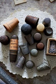 My grandmother and great grandmother were both incredible seamestresses, and my mother had their gift without a doubt.  I always saw their thimbles as tiny treasures. One of my great grandmother's was the thing I took with me to focus on when my first child was born. -Eve.