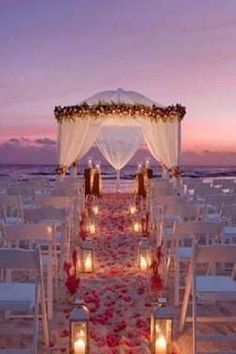 Thinking of planning a destination wedding? Our destination wedding guide has everything you need to plan your big day. Find the perfect wedding location and venue, and find expert destination wedding planning advice before you walk down the aisle. Night Beach Weddings, Beach Wedding Aisles, Wedding Aisle Decorations, Beach Ceremony, Wedding Ceremony, Wedding On The Beach, Beach Night, Beach Wedding Locations, Beach Decorations