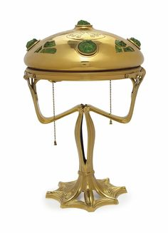A GERMAN ART NOUVEAU BRASS AND GREEN GLASS TABLE LAMP, EARLY 20TH CENTURY, MARKED 'EICHBERG' AND 'BL'