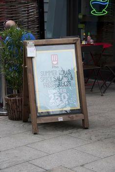 A board pavement advertisement signage