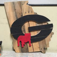 We Made A Few Of These For Some Dawg Fans This Weekend!  Are You One?  Shop Us To Get One Of These Shipped Out To You Next Week!  20% Off All Signs All Weekend Long.  Use Code: GAMEDAY For The Discount! Georgia Bulldog Room, Georgia Bulldogs Football, Football Art, College Football, Fall Wooden Door Hangers, Adult Crafts, Diy Crafts, Silhouette Sign, Rustic Wood Decor