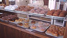 World's Best Donuts is located on the harbor in Grand Marais Minnesota. People come from all over the world to eat our donuts! Cake donuts are the staple of our business and our customers say they are the World's Best. Grand Marais Minnesota, Lake Superior, Twin Cities, Random Thoughts, Weekend Trips, North Shore, Places To Eat, Fun Things, Donuts