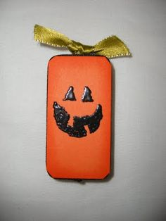 Jack-o-Lantern Domino magnets by AMANDA MERTZ; see Digital Arts & Crafts for other Domino tile crafts