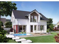 Fertighaus modern satteldach  Farbige Akzente an der Fassade - hier in Braun. #Haus #Fassade ...