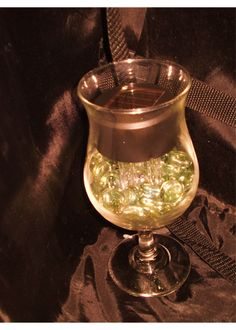 solar light in a glass with clear marbles at the bottom, Fantastic! Dollar Store, here I come.......