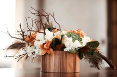 pretty for a fall wedding... with different feathers and buttercream colored stock instead of white hydrangea