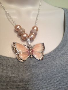 A personal favorite from my Etsy shop https://www.etsy.com/listing/230443365/sweet-blush-butterfly-necklace