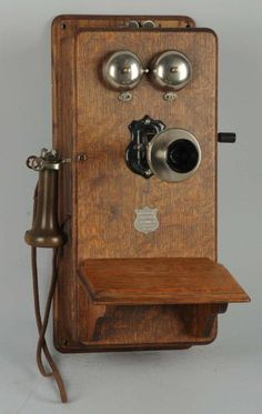 "This looks very similar to the big old wooden box phone with handle on the wall of our Grandparents home. It is Identified today as a ""Plain Front Antique Telephone"" Antique Decor, Antique Items, Antique Furniture, Vintage Items, Antique Jewelry, Pompe A Essence, Antique Phone, Deco Retro, Vintage Phones"