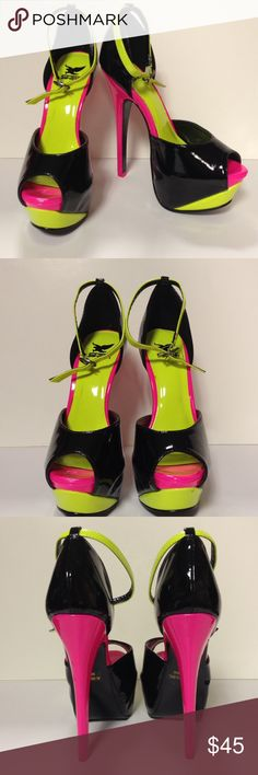 """Shiekh 6"""" black and pink spike heels size 5 These shoes are off the chain. Perfect fun pair of shoes. New.  Never been worn, but there is a small mark on the heel as noted in last picture Shiekh Shoes Heels"""