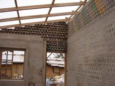 House Built With Plastic and Glass Bottles: Versión en español A friend sent me these pictures about a house that was built using recycled materials. Plastic Bottle House, Plastic Bottles, Glass Bottles, House Built, Tiny House Design, Home Art, Recycling, The Incredibles, Building