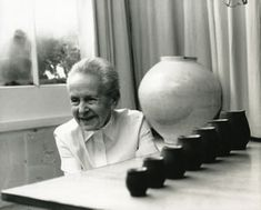 Lucie Rie with her work
