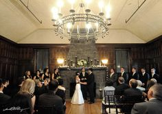 Wedding Ceremony at My Beloved Homewood in Asheville, NC in front of the rock fireplace,  Photography:  Sara Whitmeyer