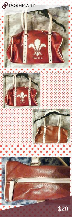 """Fleur-De-Lis Rectangular Purse/Handbag NEW W/TAGS & DEFECT Fashion Express brand Dark Red w/Pale Pink Trim Faux Leather Rectangular Purse.  *All over solid dark red & pale pink colors *Faux leather & nylon materials *Design on 1 side *Studs on both sides *1 compartment w/ zipper closure *1 zippered inner pocket *2 rounded handles *Lightweight   DEFECT: -3 smear spots on 1 handle  MEASUREMENTS: 13"""" X 8.25"""" X 3.25"""" Strap Height: 9""""  NOTE: In order to show details, I used the flash. Fashion…"""