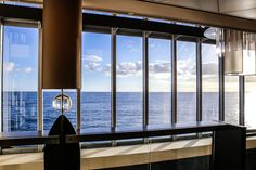 LET THERE BE LIGHT   Blick aus der verglasten Lobby der EUROPA 2 auf die See.    View from the EUROPA 2-Lobby at the sea.     MEMORABLE MOMENTS Eine Kreuzfahrt mit der EUROPA 2 / MEMORABLE MOMENTS A cruise with EUROPA 2. Foto: © Hapag-Lloyd Cruises