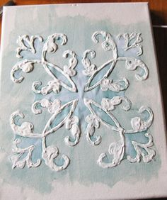 Spruce Up Any Bathroom with this Canvas Art DIY Project! - The Good Weekly  I have these cake decorating forms that would great as a drawing pattern for something likethis