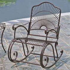 This rocking chair features a clean, classic design with smooth scrollwork and artfully crafted with metal, perfect for your outdoor oasis