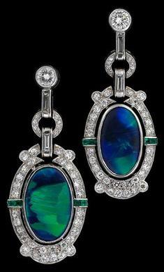 A pair of Art Deco platinum, opal & diamond earrings. Oval black opal in petite round cut diamond surround, accented by petite calibré cut emeralds; post backing. Bijoux Art Deco, Art Nouveau Jewelry, Art Deco Earrings, Opal Earrings, Opal Jewelry, Jewelry Art, Antique Jewelry, Vintage Jewelry, Fine Jewelry