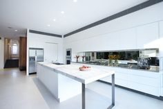 White Kitchen Island, Marble Counter, Enclave House in Melbourne, Australia by BKK Architects