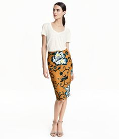 Knee-length pencil skirt in thick fabric with a visible zip and slit at back. Unlined.