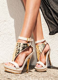 Plated Strappy Heels. Every heartbreaker needs some super stunner heels. These platform heels feature a crinkled faux leather upper that is topped off with a cut-out, triangle shaped metal plate. These open-toe shoes feature an adjustable buckled ankle strap and metallic accents along the heel and platform.