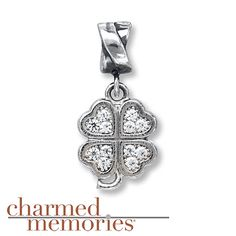 Shimmering SWAROVSKI ELEMENTS adorn this enchanting four-leaf clover charm for her from the Charmed Memories® collection. The charm is styled in sterling silver.