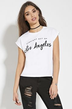 """This knit tee features cuffed short sleeves, a round neckline, and a """"Straight Out Of Los Angeles"""" graphic on the front."""