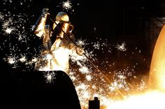 Sparkle: A man in protective gear worked at a ThyssenKrupp AG steel factory in Duisburg, Germany. Ph: Ina Fassbender/Reuters