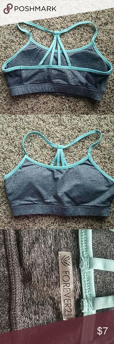 Cute sports bra with inserts Grey sports bra with teal straps. No signs of wear. Size medium :) for reference it's like a size 4-6 lululemom. Cute mesh panels on side. Forever 21 Tops