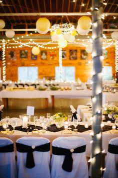 Twinkle Lights and Paper Lanters really transformed this camp Mess Hall into a beautiful reception space {Abby + Matt's Summer Camp DIY Wedding}