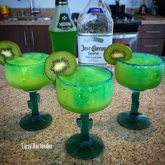 Electric Kiwi Margarita Cocktail - For more delicious recipes and drinks, visit us here: www.tipsybartender.com