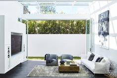 A monochromatic living area that opens up to the outside.