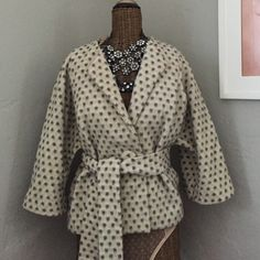 Retro French connection coat This beautiful French connection coat looks very retro/classy and is in perfect condition. It's pretty warm since it's made mostly of wool. And is a size 6. French Connection Jackets & Coats Pea Coats