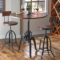 """Add a unique focal point to any room with this steam-punk inspired pub table. With comfort in mind, the table's most distinguishing feature is the fully functioning hand crank, designed to adjust the height of the table top. Stools are also adjustable to desired height from 23"""" to 30"""" H and have removable backs."""