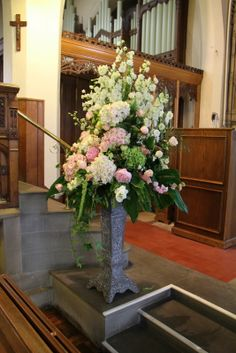 At the top of the aisle framing the ceremony space were two majestic pedestal designs dominated by elegant Delphiniums, the focal area was full and luscious with dramatic Hydrangeas, Peonies, Roses, Stocks and Sweet Williams