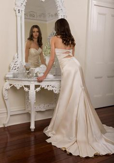 The back of this dress is so gorgeous, I'm in love. I may be changing my mind about a favorite dress... Best Designer Wedding Dresses