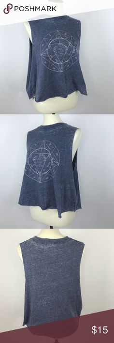 """Brandy Melville Graphic Tee Brandy Melville Graphic Muscle Tee it's perfect for festival season or just everyday wear in general. It fits oversized so makes the wear very comfortable. Gently used, in very good condition.   Material: Polyester/Celton Measurements:  22""""(Pit to pit) 7"""" (pit to hem) Brandy Melville Tops Muscle Tees"""