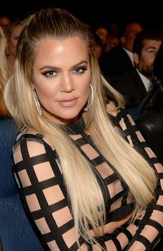 Khloe Kardashian attended the ESPY Awards in Los Angeles with bleach blonde hair that was styled straight and slightly slicked back. See how you can copy her sleek, frizz-free straight hairstyle.