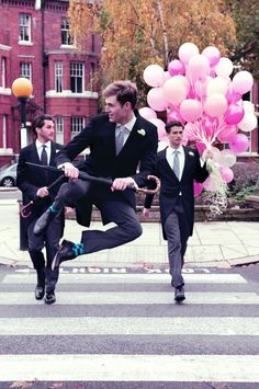 quite possibly the jolliest picture ever:  pink balloons & jumping men in suits.