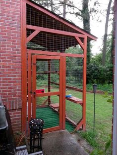 """Pinner stated: """"8' x 10' x 12'catio stained wood to match house. Cats exit through pet stairs on inside then a expandable pet window door from eBay.  Inside shelves for basking in the sun and to get down to other levels/toys/auto littermaids w/covers. Also has a shingled roof! Astroturf on bottom, 3sliding locks on the door/combo lock. Great way to let my 4 indoor rescue cats be outside safely. They spend ALL day out there most days in this DIY! #cats #CatEnclosures"""