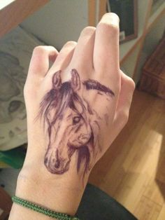 horse tattoo on hand - http://www.cuded.com/2015/12/40-awesome-horse-tattoos/